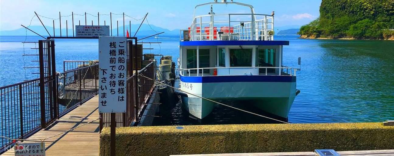a boat docked at the Osaka Boat House area